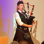 Kirstine Folmann opens the conference with bagpipe music.